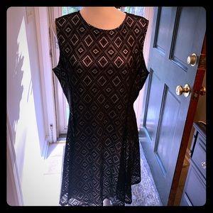 Black lace over white shell sleeveless dress.